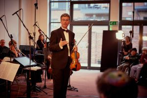 25th May 2016: Rabbi Kaminetsky leads musical proceedings at Birmingham Central's Lag b'Omer Concert