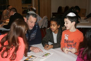 31st October 2015:  Children of the Allerton congregation enjoy a  learning session with their parents and grandparents after Shabbat