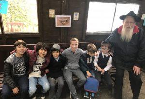 23rd October 2016: Children of the Singer's Hill community enjoyed a 'Sukkah Crawl Bus Hop'