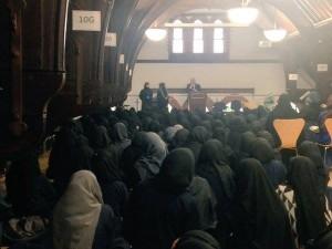 Muslim schoolgirls listen to the Chief Rabbi speak