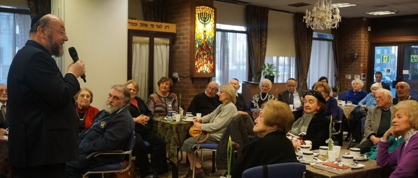 Chief Rabbi Mirvis with Holocaust survivors