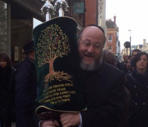 Chief Rabbi Mirvis dances with a new Sefer Torah