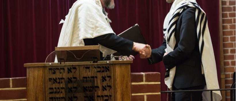 Rabbi Daniel Sturgess shakes hands with the Chief Rabbi upon taking the helm of St Albans