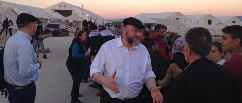 Chief Rabbi Mirvis listens to the personal stories of migrants who have fled their war-torn homelands