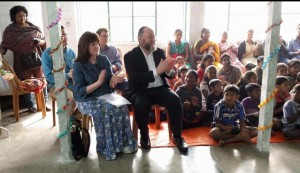 The Chief Rabbi and Valerie Mirvis enjoy a performance by children supported by the Economic Rural Development Society