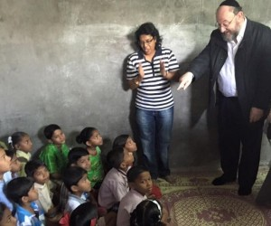 A class of children supported by The Gabriel Project listen to the Chief Rabbi as he teaches them English