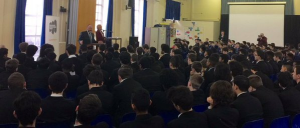 William Ellis Academy students listen as the Chief Rabbi urges them to preserve the memory of the Holocaust